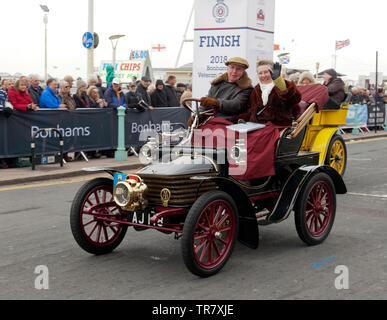 Mr Ken Goddard driving his 1904 Wolseley, across the finishing line of the 2018, London to Brighton Veteran Car Run - Stock Image
