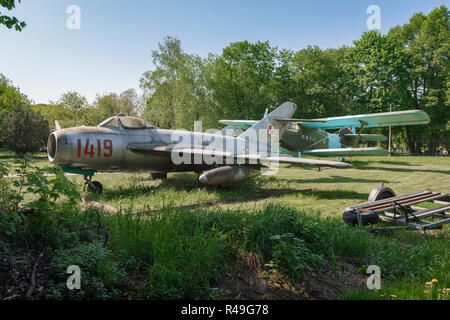 1960s soviet russian jet fighter, view of a Warsaw Pact era jet fighter aircraft displayed in a field in the Poznan Museum of Armaments, Poland. - Stock Image
