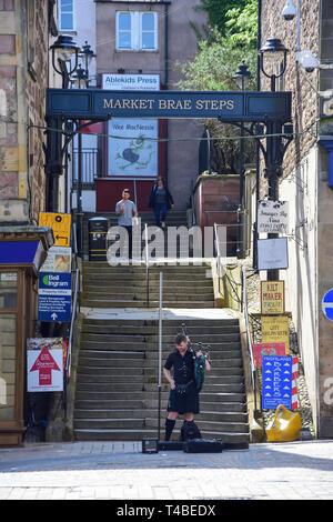 Scottish bagpiper below Market Brae Steps, Inverness, Highland, Scotland, United Kingdom - Stock Image
