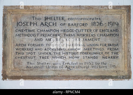 Joseph Arch memorial plaque located in a bus shelter near the spot where he gave his famous inaugural speech. - Stock Image