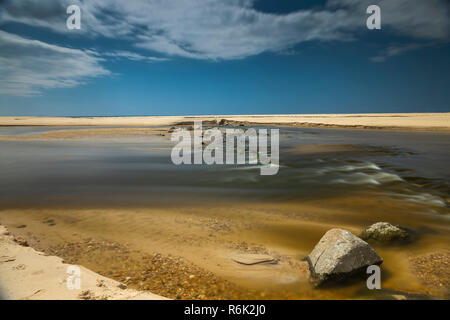 Long Pause, tide going out, France. - Stock Image