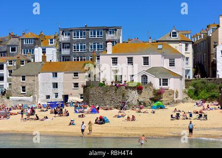 People holidaymakers sunbathing on St Ives beach,Cornwall,England,UK - Stock Image