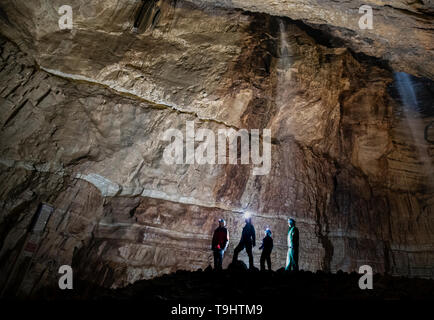 Potholers explore Gaping Gill, the largest cavern in Britain, situated in Yorkshire Dales National Park, ahead of its opening the public next weekend. - Stock Image
