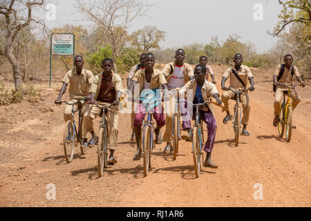 Yako Province, Burkina Faso; Boys return from school near Samba. - Stock Image
