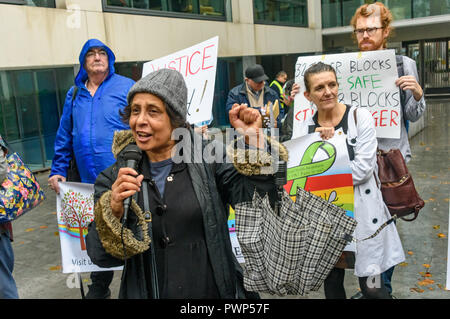 London, UK. 17th October 2018. A woman speaks about the succesful campaign in Haringey against council plans for a £2 billion transfer of housing estates and other public assets to a private developer at the protest outside the Ministry of Housing, Communities and Local Government by residents living in tower blocks covered in Grenfell-style cladding, Fuel Poverty Action, and Grenfell campaigners demanding that the government make all tower-block homes safe and warm. Credit: Peter Marshall/Alamy Live News - Stock Image