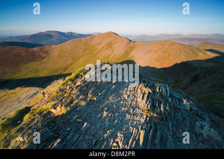 Looking towards Grisedale Pike  from the summit of Hopegill Head at sunset in the Lake District - Stock Image