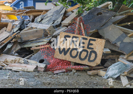 Building site sign offering up wood remnants. - Stock Image