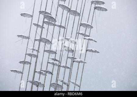Thessaloniki, Greece. 09th Jan, 2019. Umbrellas sculpture by George Zongolopoulos artist during a heavy snowfall in Thessaloniki, Greece on January 9, 2019.  Credit: Konstantinos Tsakalidis/Alamy Live News - Stock Image