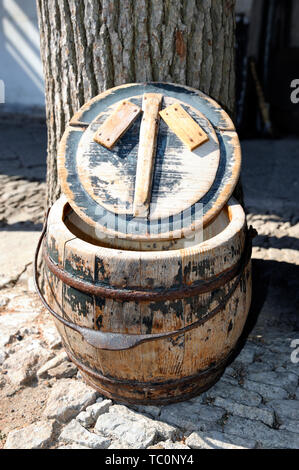 Old Chinese wooden basket that was used in the bathroom. The feces and the urine were received in the basket and once a week the basket were cleaned. - Stock Image