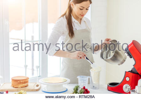 talented chef has prepared cream for treat, close up photo. - Stock Image