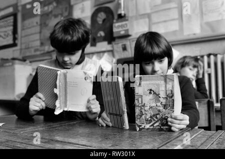 Education: Lack of text books in the early 1980's led to school children having to share books. Books were repaired many times and were only replaced when they could not be read. March 1981 PM 81-01143-003 - Stock Image