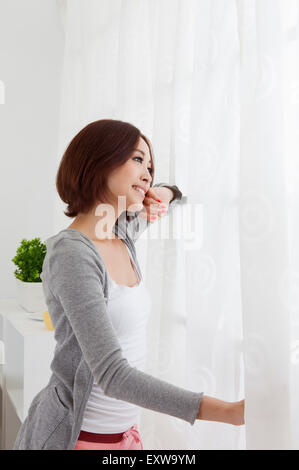 Young woman looking away with smile, - Stock Image