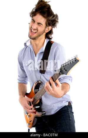 young rock star holding guitar - Stock Image