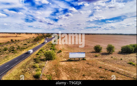 Flat cultivated argiculture plains along Newell highway around Moree rural regional town on artesian basin in NSW outback, Australia. - Stock Image