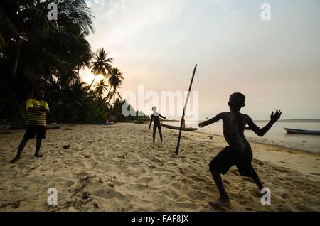 Boys playing a game on a beach on Yele Island, Turtle Islands, Sierra Leone. - Stock Image