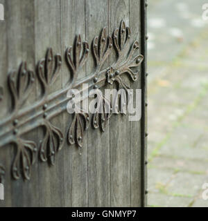 Wooden door with decorative hinge detail. Part of the old St Michael and All Angels Church in Stourport. - Stock Image