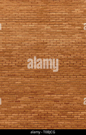 Red beige bricks stone wall decorative background closeup, vertical grunge pattern, old aged weathered texture natural grungy textured reddish vintage - Stock Image