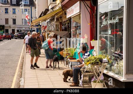 UK, England, Yorkshire, Filey, John Street, visitors looking at shops - Stock Image