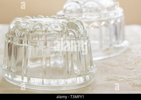 Old fashioned glass jelly or blancmange moulds for making traditional jellies - Stock Image