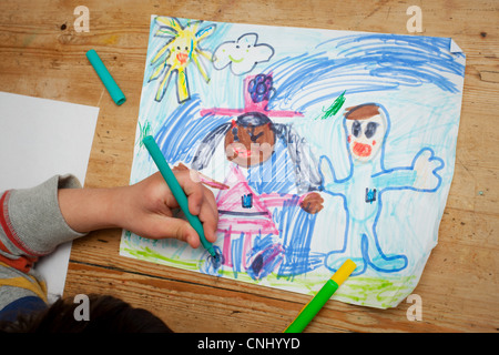Child drawing a picture - Stock Image