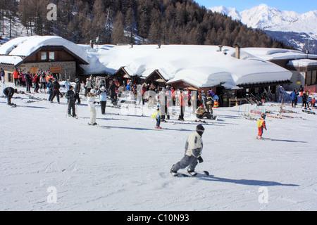 Skiing at the mountain Malga Panciana, Marilleva, Italy - Stock Image