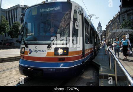people getting on Sheffield city supertram, Sheffield, Yorkshire, England - Stock Image
