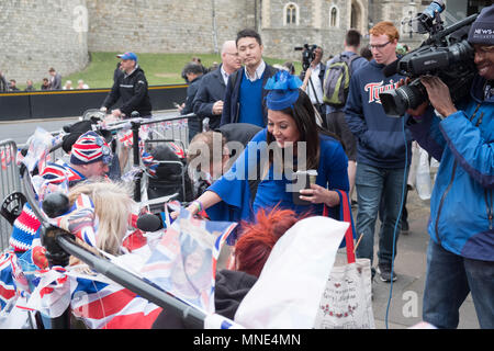 Royal Wedding preparations in Windsor town centre. Early Royal fans are staking claim to viewing spots and happy to be interviewed by multiple media personnel. - Stock Image