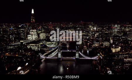 Beautiful Panoramic Night Aerial View of New London Cityscape and Landmarks around Tower Bridge and Thames River feat. Famous Skyscrapers - Stock Image