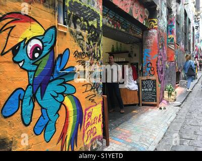 Hosier Lane in Melbourne with coffee shop and street art - Stock Image