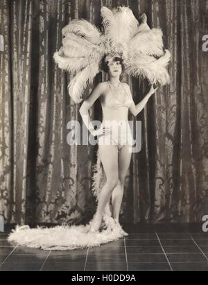 Showgirl wearing feather headdress and sequined bikini - Stock Image