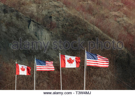 Canadian and American flags together part of a movie set. - Stock Image