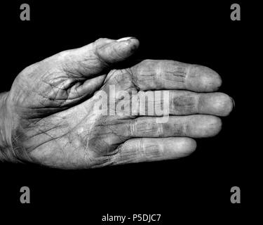 A black and white shot of a weathered character hand showing old skin. - Stock Image