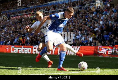 Derby County's Martyn Waghorn (left) and Birmingham City's Harlee Dean battle for the ball during the Sky Bet Championship match at St Andrew's Trillion Trophy Stadium, Birmingham. - Stock Image