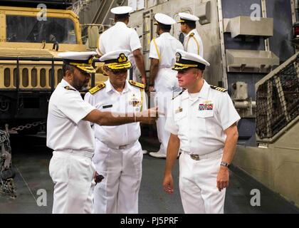 180825-N-PH222-0219 TRINCOMALEE, SRI LANKA (Aug. 25, 2018) Capt. Dennis Jacko, commanding officer of San Antonio-class amphibious transport dock USS Anchorage (LPD 23), from Sayreville, N.J., right, speaks to distinguished visitors of the Sri Lanka navy during a regularly scheduled deployment of the Essex Amphibious Ready Group (ARG) and 13th Marine Expeditionary Unit (MEU). Anchorage and the embarked Marines of the 13th MEU are conducting a theater security cooperation exercise with the Sri Lankan navy and marines. Part of a growing U.S.-Sri Lanka naval partnership, the exercise is also an op - Stock Image