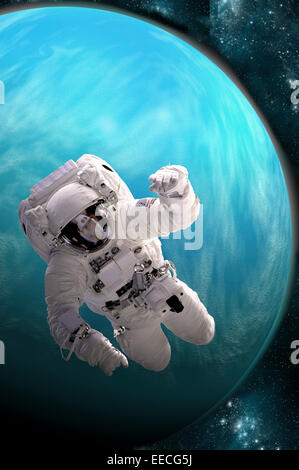 Artist's concept of an astronaut floating in outer space. A water covered planet is illuminated by a nearby - Stock Image
