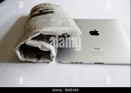 Newspaper compared to Apple iPad, Touchscreen Tablet Computer, Book Reader, Digital Ebook, Modern, Logo, Brand, - Stock Image