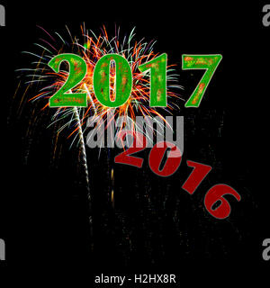 Year 2017 numbers with 2016 fading away fireworks on black background for New Year's Day or New Year's Eve - Stock Image