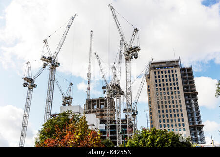 Tower cranes, building work, construction, cranes, tower crane, London construction, Construction UK, London flats, working at heights, London, UK, - Stock Image