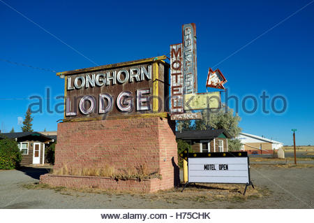 Longhorn Lodge - roadside motel open for business, on US Route 30/287. Rock River, Wyoming, USA. - Stock Image