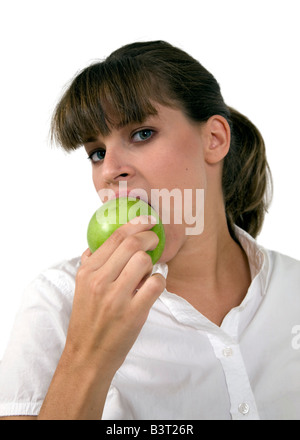 close up of woman eating apple on isolated background - Stock Image