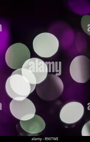 Bokeh created by blurred Christmas tree lights - Stock Image