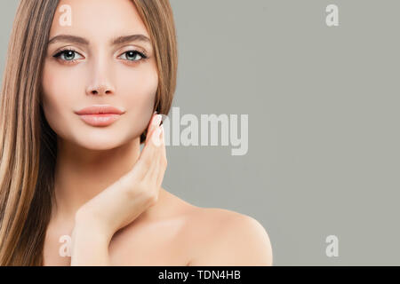 Beautiful face closeup. Healthy model woman with clear skin and healthy hair. Skincare and facial treatment concept - Stock Image