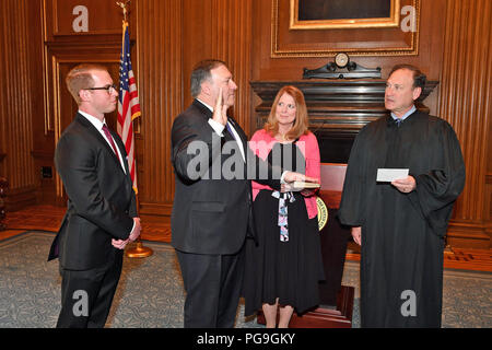U.S. Secretary of State- designate Mike Pompeo is sworn-in as the 70th Secretary of State by Supreme Court Justice Samuel Alito in the West Conference Room of the Supreme Court in Washington, D.C. on April 26, 2018. - Stock Image