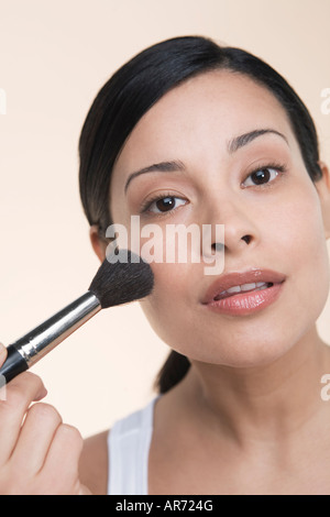 Woman applying makeup - Stock Image