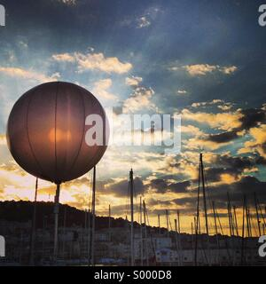 Sunset at a port in Sete, Southern France during a music festival - Stock Image
