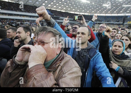 Kiev, Ukraine. 19th Apr, 2019. Supporters of Ukrainian comedian actor and presidential candidate VOLODYMYR ZELENSKIY react during his debate with Ukrainian President and Presidential candidate PETRO POROSHENKO at the Olimpiyskiy Stadium in Kiev, Ukraine, 19 April 2019. The second round of presidential elections will held on April 21. Credit: Serg Glovny/ZUMA Wire/Alamy Live News - Stock Image