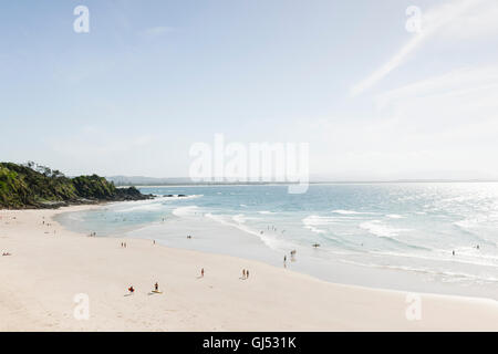 People bathing and surfing at Wategos Beach in Byron Bay. - Stock Image