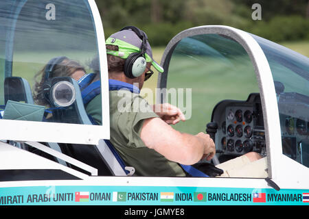 Pilot of the Texan Top Class touristic airplane preparing to fly. - Stock Image