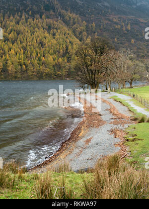 Waves on the shoreline of lake Buttermere in the English Lake District, Cumbria, UK - Stock Image
