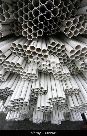 A section of bundled irrigation pipes. - Stock Image